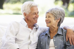 Senior Couple Relaxing On Sofa At Home Stock Photo
