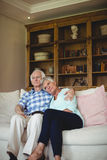 Senior couple relaxing on sofa in living room Royalty Free Stock Images