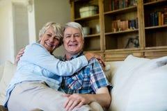 Senior couple relaxing on sofa in living room Stock Photo