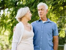 Senior couple relaxing in park stock photo
