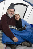 Senior Couple Relaxing In Tent Stock Image