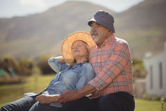 Senior couple relaxing together on bench Stock Photography