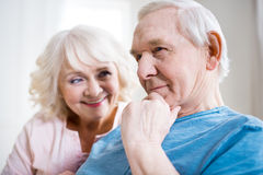 Senior couple relaxing together at home, man thinking Royalty Free Stock Photography