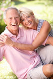 Senior couple relaxing together in park Stock Photography