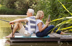 Elderly couple fishing together stock photo image 41856481 for Old wife fish