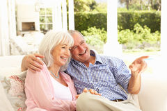 Senior Couple Relaxing Together On Sofa Royalty Free Stock Photo