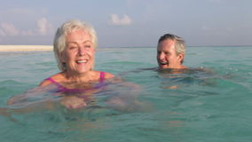 Senior Couple Relaxing In Tropical Sea stock video