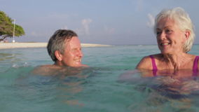 Senior Couple Relaxing In Tropical Sea stock video footage