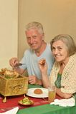 Senior couple at restaurant Stock Photos