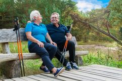 Senior couple resting after nordic walking royalty free stock images