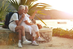 Senior couple resting outdoors. Portrait of a happy senior couple resting outdoors Stock Image