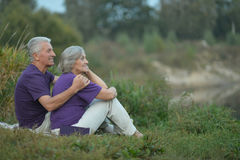 Senior couple resting outdoors. Portrait of a happy senior couple resting outdoors Royalty Free Stock Image