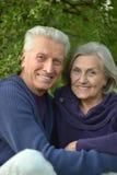 Senior couple resting outdoors Stock Photos
