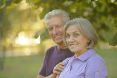 Senior couple resting outdoors Stock Photo