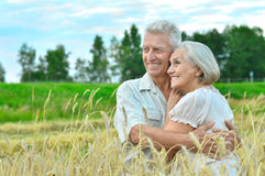 Senior couple resting at  summer field Royalty Free Stock Photography