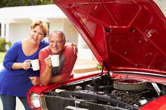 Senior Couple With Restored Classic Car Stock Photos