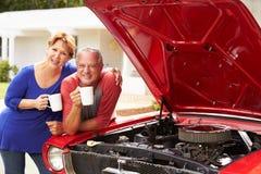 Senior Couple With Restored Classic Car Stock Photos