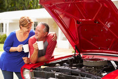 Senior Couple With Restored Classic Car Royalty Free Stock Images