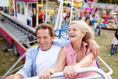 Senior couple on a ride in amusement park Stock Images