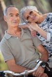 Senior couple riding bikes Royalty Free Stock Images