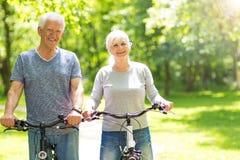 Senior Couple Riding Bikes Royalty Free Stock Photos