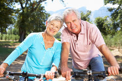 Senior couple riding through countryside Royalty Free Stock Photo