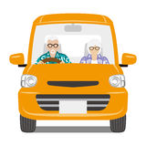 Senior Couple riding the Orange color car ,front view - Isolated Stock Photo