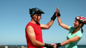 Senior couple roller blading along the pier and high fiving stock video