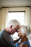 Senior couple romancing in bedroom Stock Photography