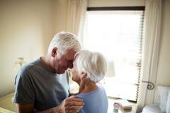 Senior couple romancing in bedroom Royalty Free Stock Photos
