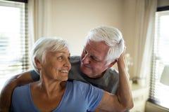 Senior couple romancing in bedroom Stock Photo
