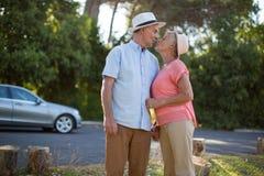 Senior couple romancing at roadside Stock Image