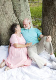 Senior Couple - Romantic Date. Senior couple on a romantic date in the park.  Vertical view, full body Royalty Free Stock Images