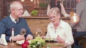 Senior couple on a romantic date having a conversation stock video footage