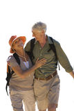 Senior couple with rucksacks walking, cut out Stock Photography