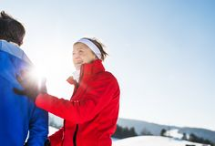 Senior couple runners standing in winter nature, resting. Copy space. royalty free stock photos