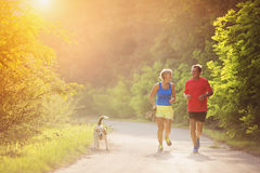 Senior couple running Stock Images
