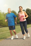 Senior couple running. royalty free stock photos