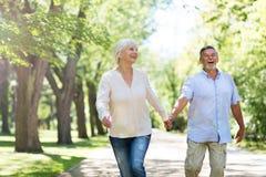 Senior couple running. Loving senior couple standing outdoors Stock Images