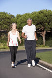 Senior Couple Running On Road Stock Image
