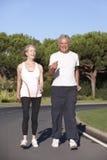 Senior Couple Running On Road Stock Photos
