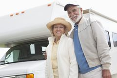 Senior Couple And RV Home. Portrait of a happy Senior couple and RV home Royalty Free Stock Images