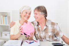Senior couple saving money Royalty Free Stock Photo