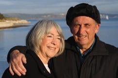 Senior couple by the sea. stock photos