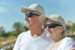 Senior couple at sea in sunglasses Royalty Free Stock Photo