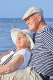 Senior couple at the sea. Two elders on the beach near the water in sailors suits Stock Photo
