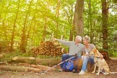 Senior couple seeing goal of hiking trip Stock Image