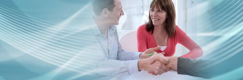 Senior couple shaking hands with realtor. panoramic banner royalty free stock images