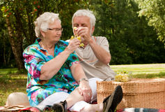 Senior couple sharing the grapes Stock Photo