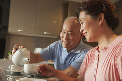 Senior couple sharing tea Stock Images